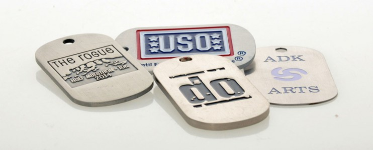 Etched, colouer-filled dog tags